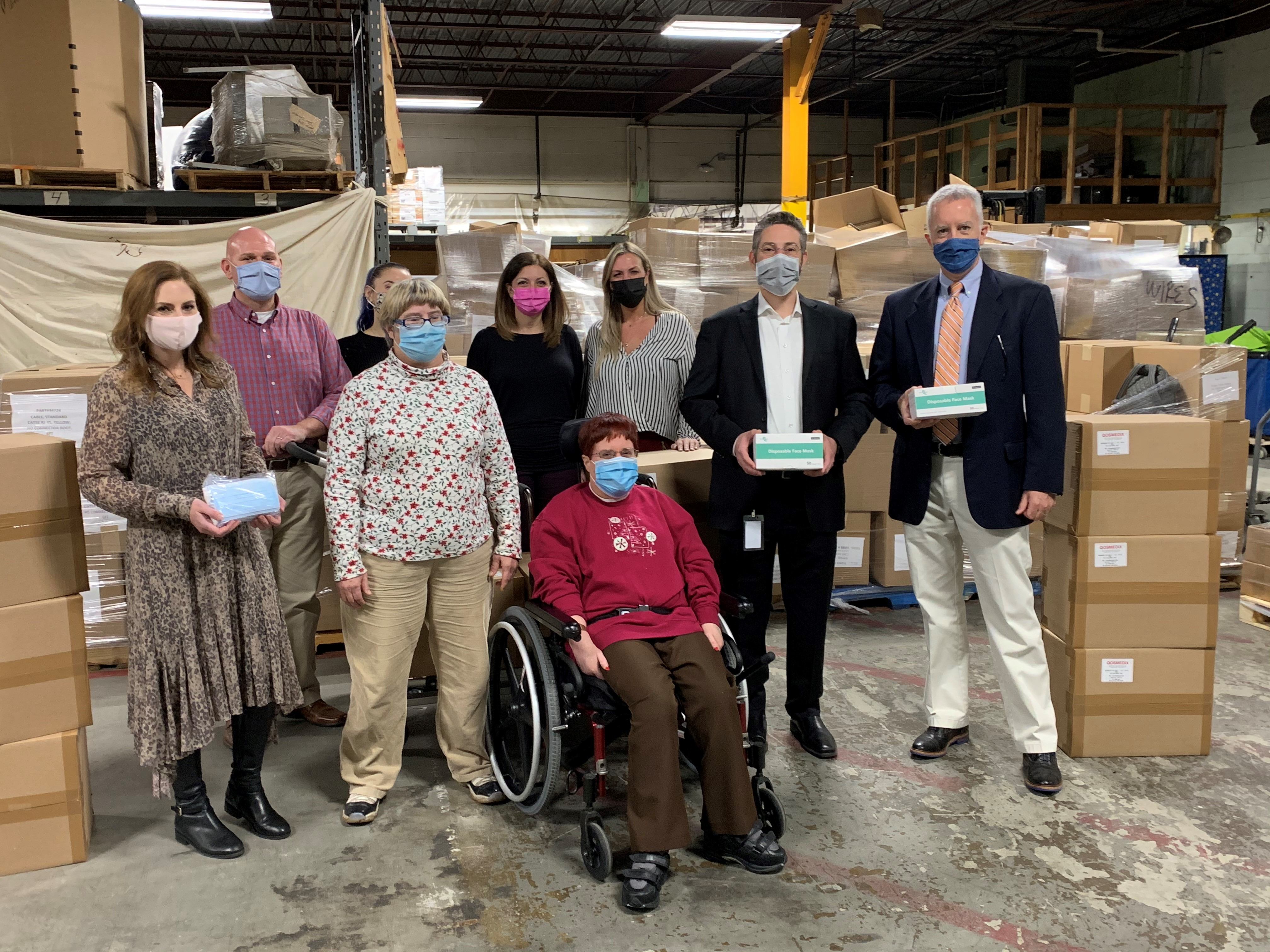 The Qosina team donates 240 much-needed boxes of ear loop masks to AHRC Suffolk.